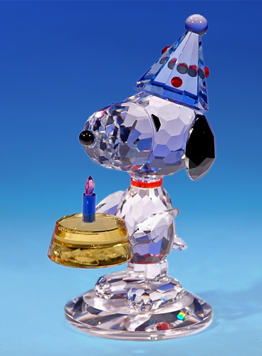 Snoopy crystal figurine with birthday cake - 'The Birthday Beagle'.